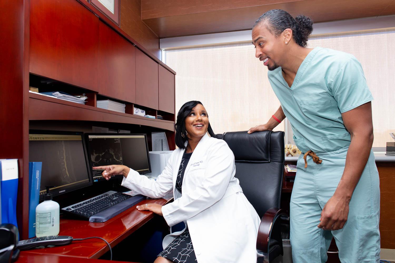 doctor talking to employee