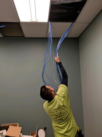 guy looking at wiring