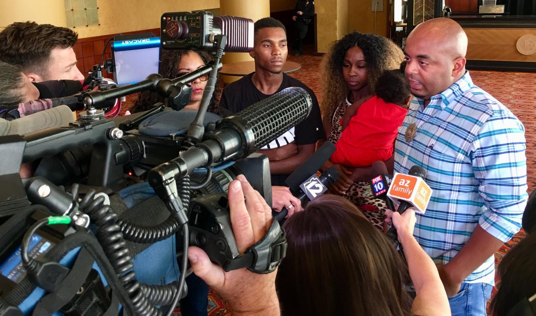 Reporters surround couple