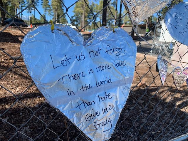 Foil heart on fence after hate crime.