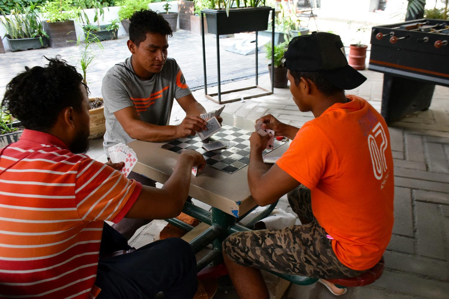 Migrants playing cards