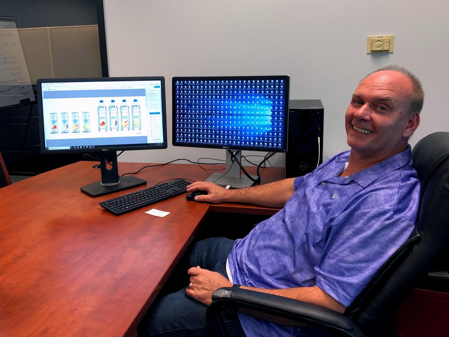 CEO of Alkaline Water Co. sits in his Scottsdale office