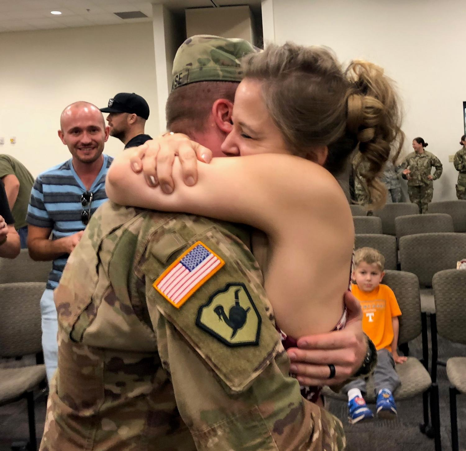 Capt. Jacob Morehouse reunites with his wife Crystal Morehouse.