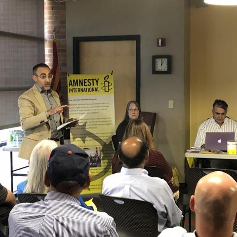 Imraan Mir, a native of Kashmir, gives a lecture for Amnesty International