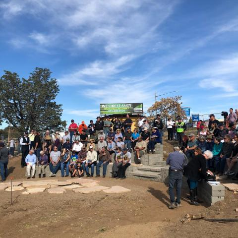 A crowd gathers at the Yarnell Hill Fire Memorial Park to watch the unveiling ceremony for a memorial dedicated to the 19 firefighters who died protecting the town during a 2013 wildfire.