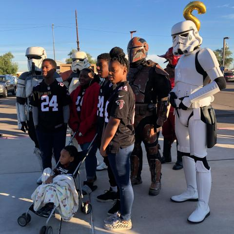 12-year-old Jade (front) poses with her adoptive family and Star Wars characters at a National Adoption Day event at the Maricopa County Juvenile Court, Nov. 23, 2019.