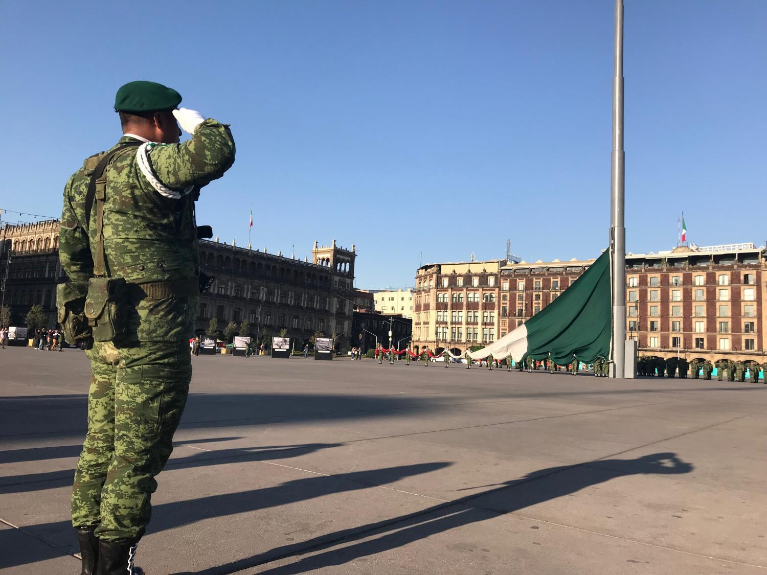 Mexican military police soldiers raising the Mexican flag