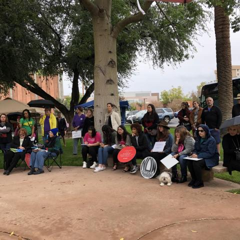 An audience gathers during a rally for the National Organization of Women (NOW) at the state Capitol Dec. 8, 2019.