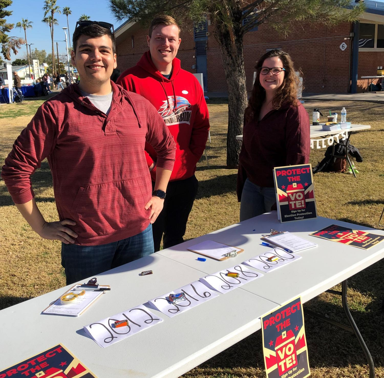 Tim Hernandez (left), Travis Huber (middle), and Caroline Livingston (right) recruit volunteer poll monitors for the upcoming 2020 election cycle in Arizona.