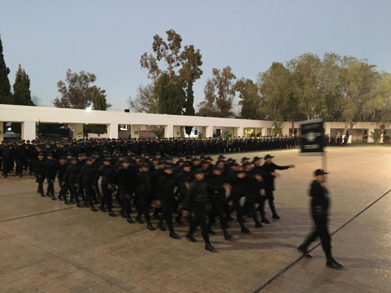 The cadets in Mexico's federal police academy march across an esplanade every morning and evening