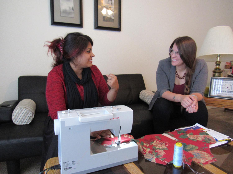 Noreen Amir (left) talks with Danielle Luna