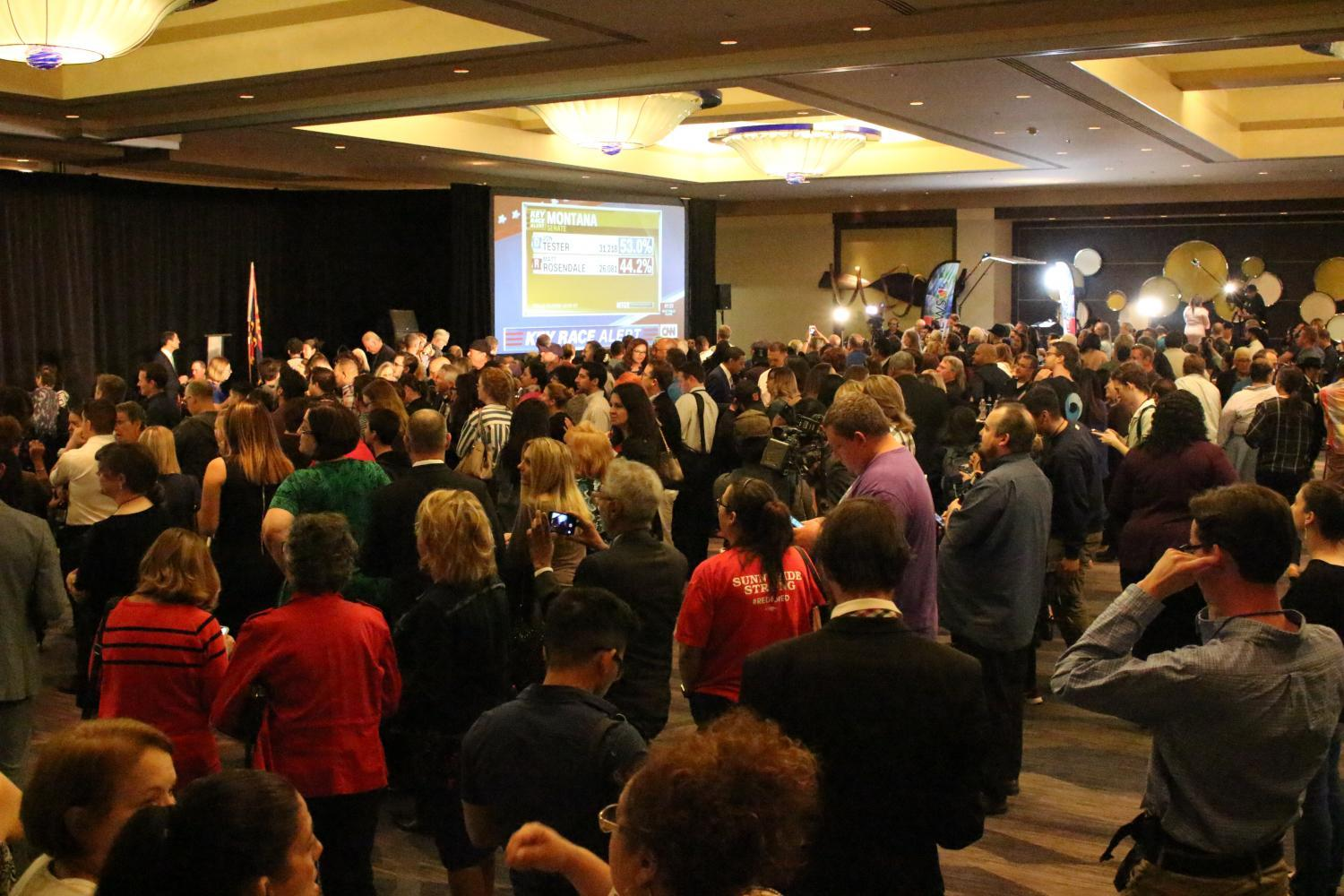 Democrats watch the returns come in from downtown Phoenix on election night.