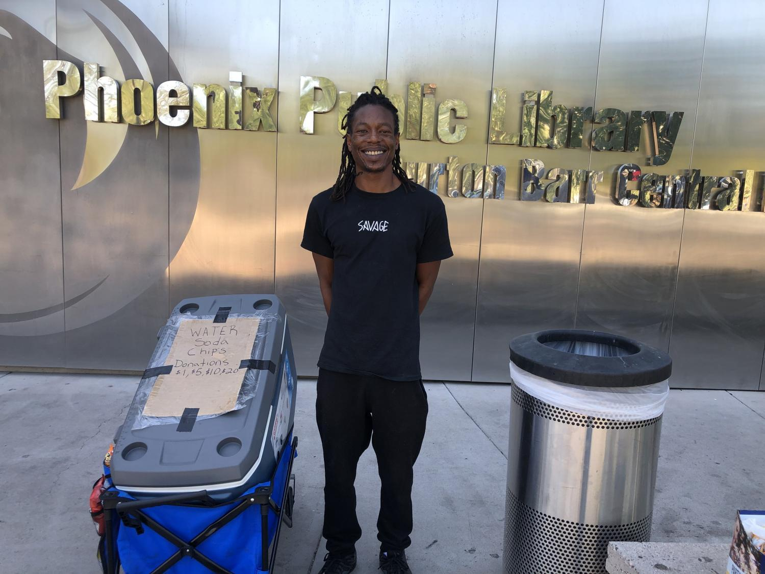 Yahshua McDuffie and his cooler full of ice water