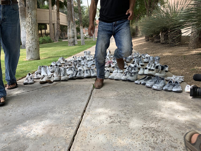 No More Deaths activists place donated shoes