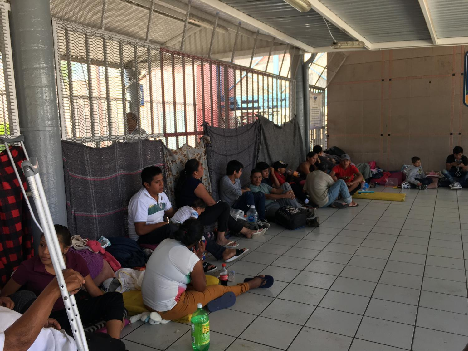 Asylum seekers wait their turn to cross into the U.S. from Nogales