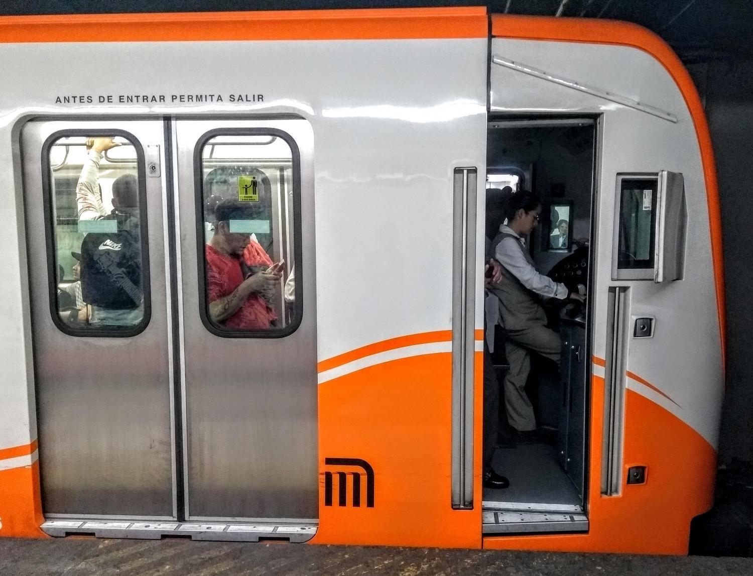 A female driver rides one of the newst trains in Mexico City