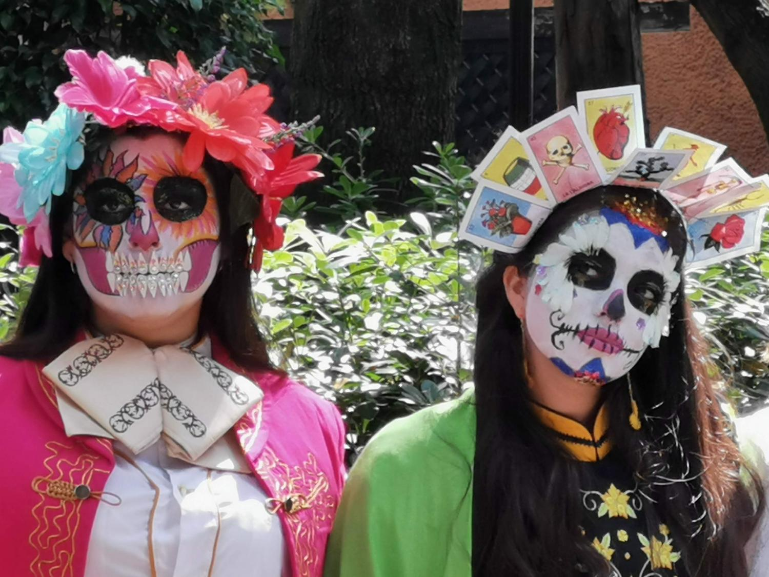 "Two women dressed up as ""Catrinas"""