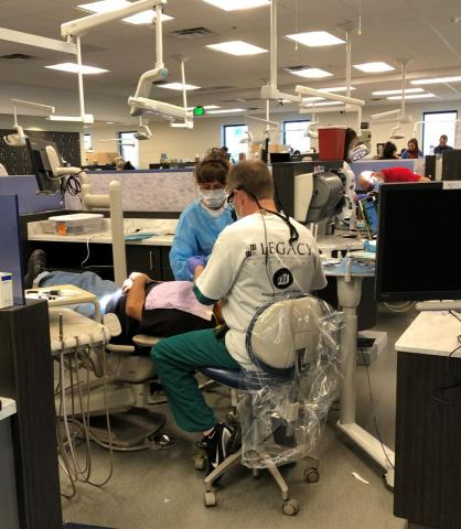 Volunteer dentists drill for a filling.