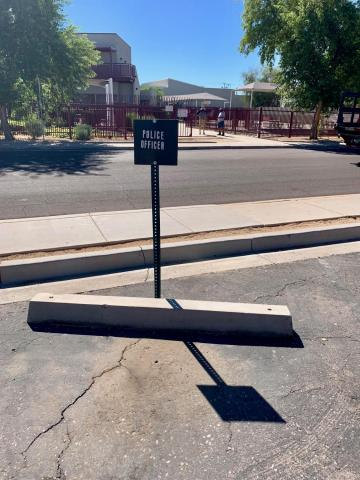 The police officer parking spot is empty at Wilson Elementary School.