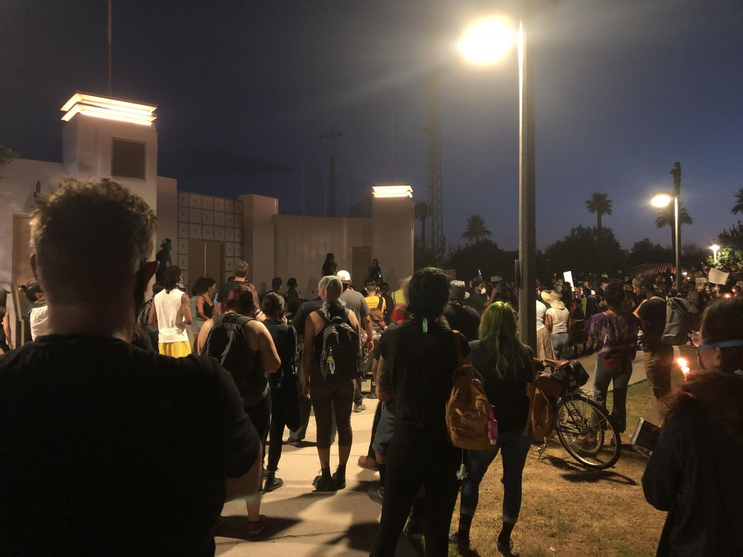 A vigil for Dion Johnson, who was killed by a state trooper Monday, May 25th.