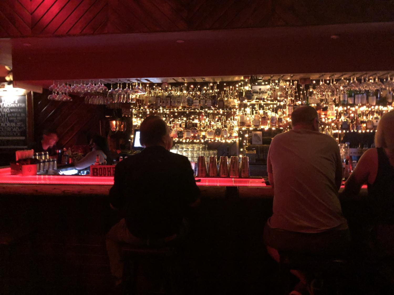 Customers sit at the bar at The Little Woody in Arcadia.