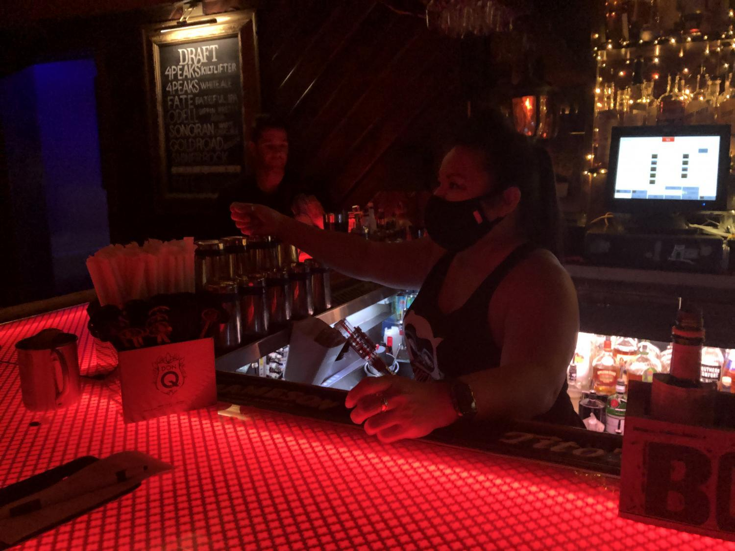 Elle Hoyt serves customers at The Little Woody for the first time since June.