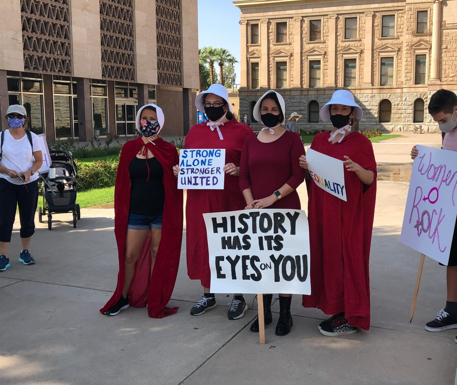 "Demonstrators dressed as characters from ""The Handmaids Tale"""