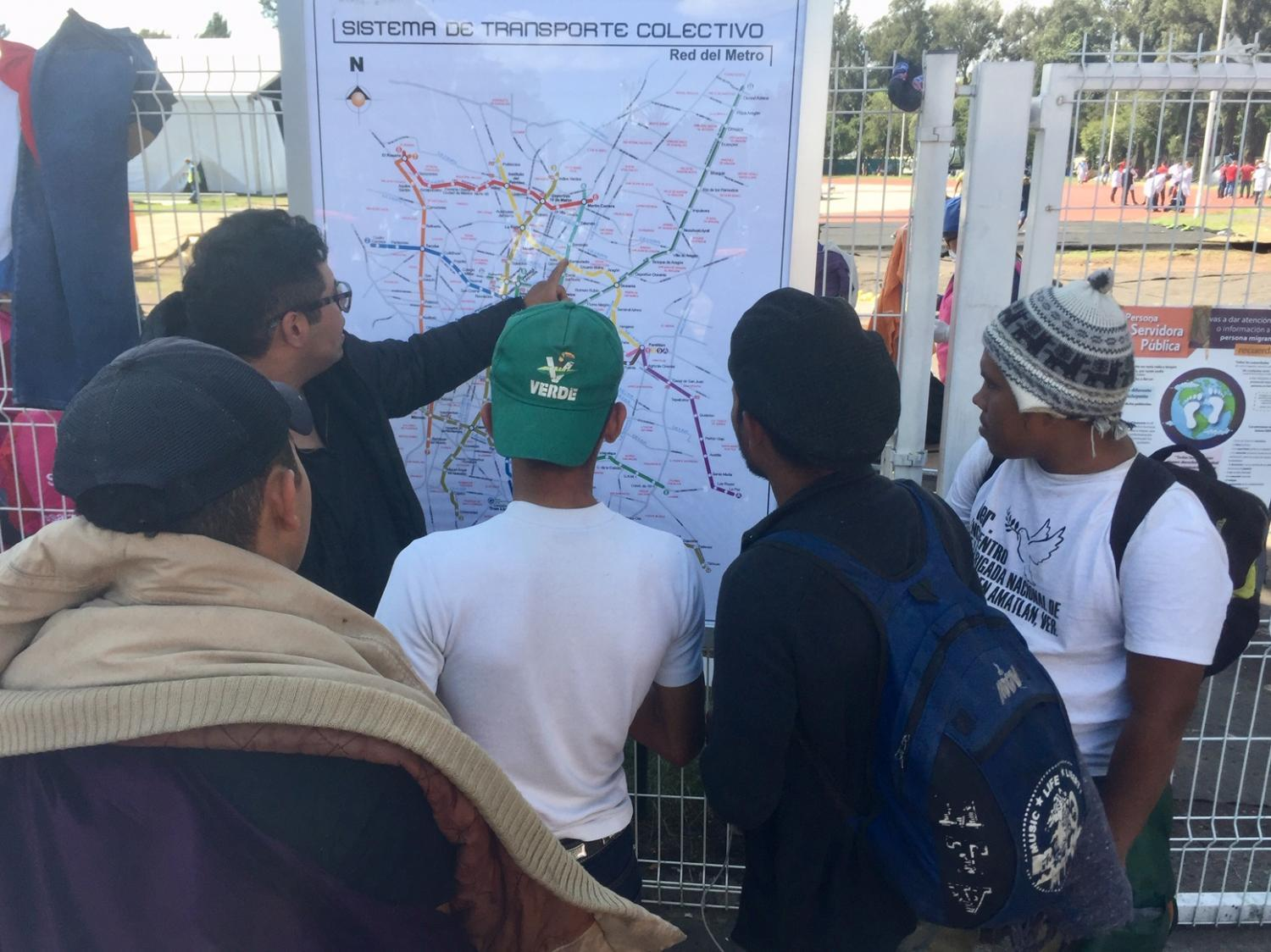 Central American migrants check Mexico City