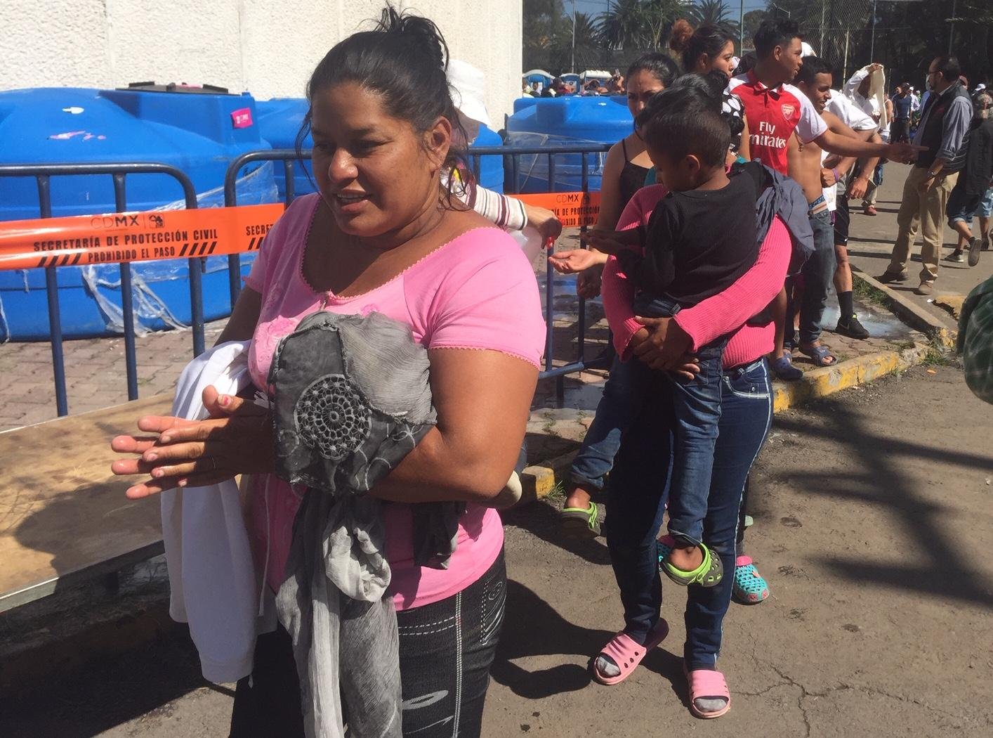 Mothers wait on line to get food for their children at the migrant shelter in Mexico City.