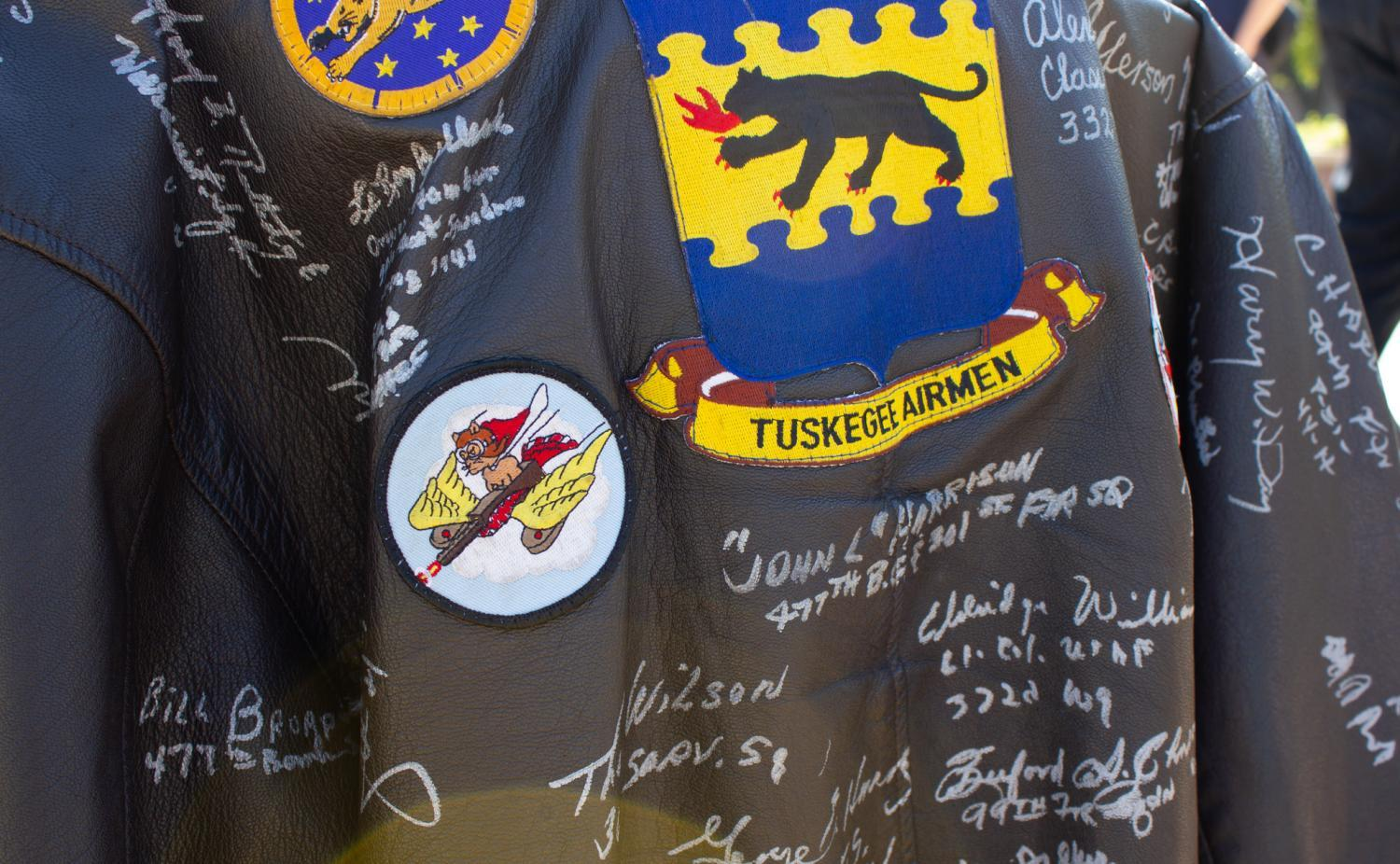 A jacket owned by Maj. George W. Biggs signed by fellow Tuskegee Airmen.