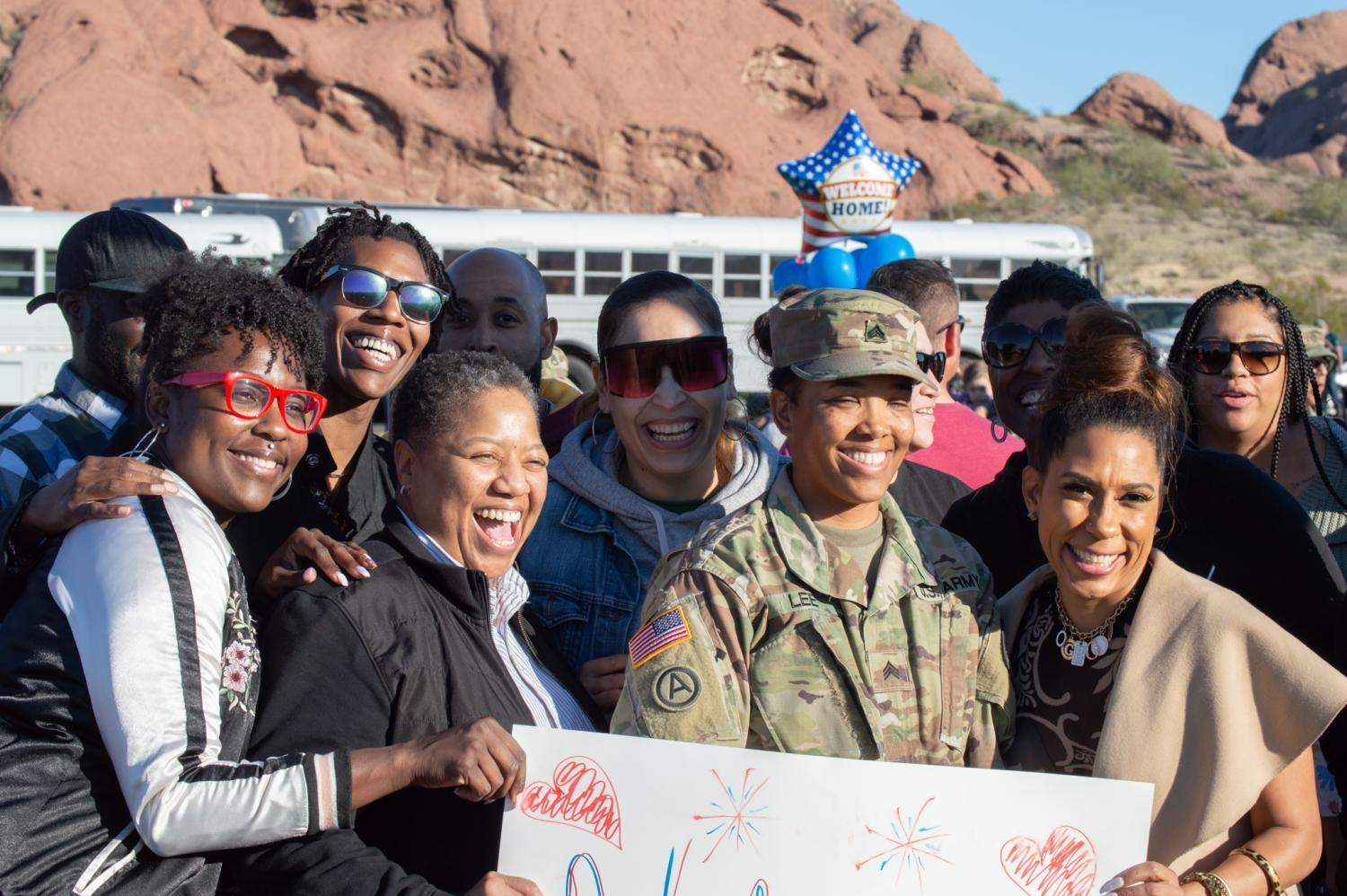 The family of Sgt. Kesha Lee poses for a photo after Sgt. Lee