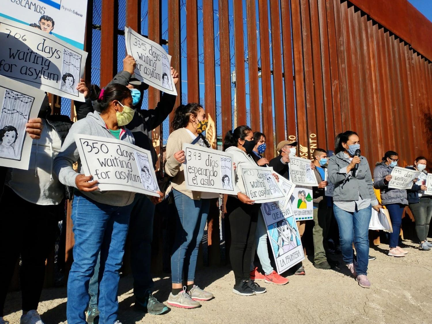 Migrants and asylum seekers at the border wall