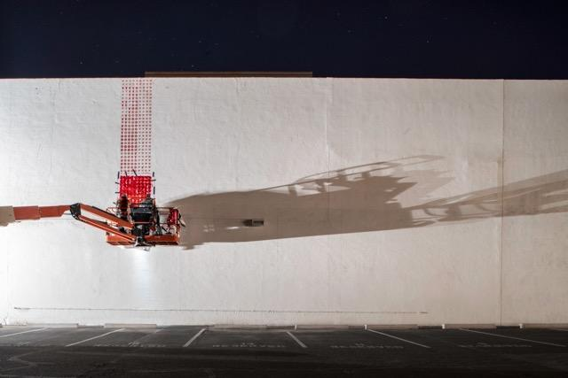 Artist Aaron Bass works on the Maverick Mural in Scottsdale
