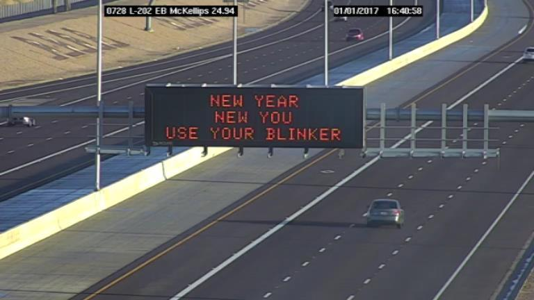 """Through our Q&AZ reporting project, one listener asked : """"Who does those funny electronic signs. Is it one person or a team?"""""""