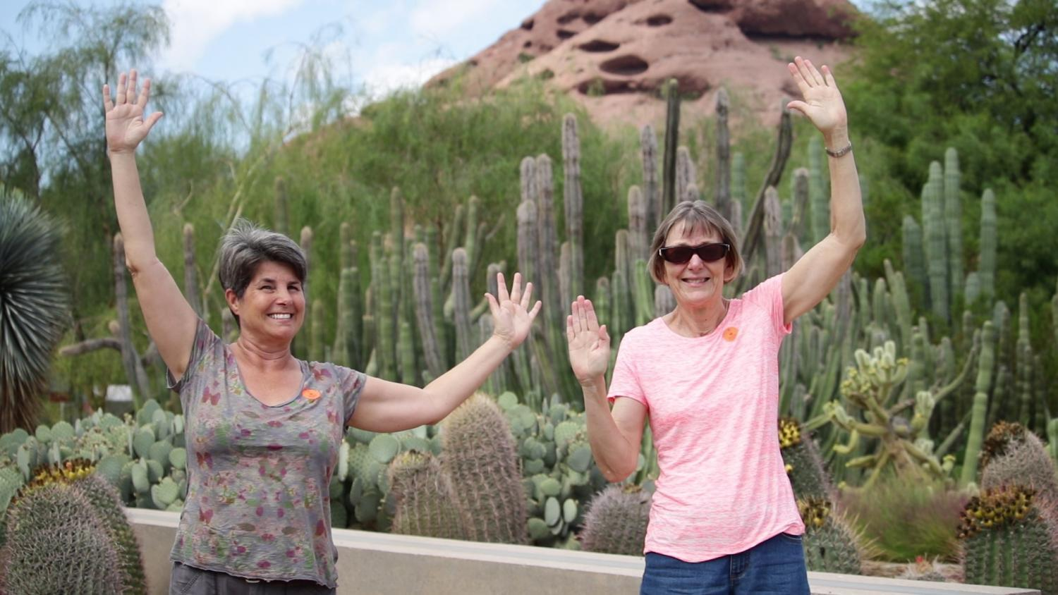 Jeannie Heiden and Patricia Lamb pose as saguaro cacti