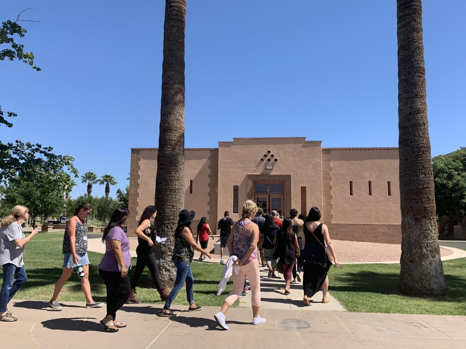 Teachers walk into the Phoenix Indian School Visitor Center