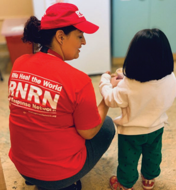 Jessica Rose, an RN from Arizona, with a young patient