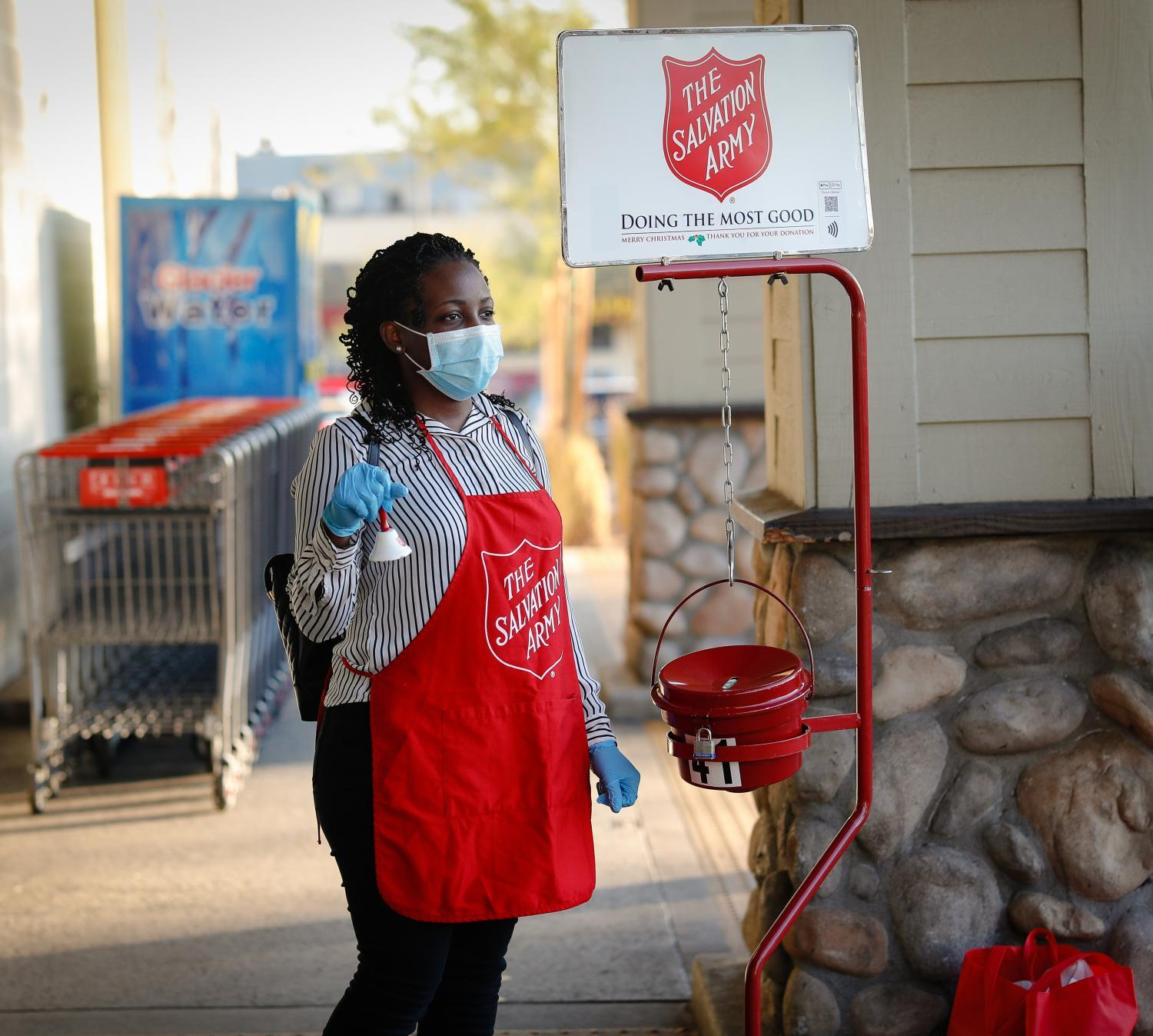masked salvation army bell ringer