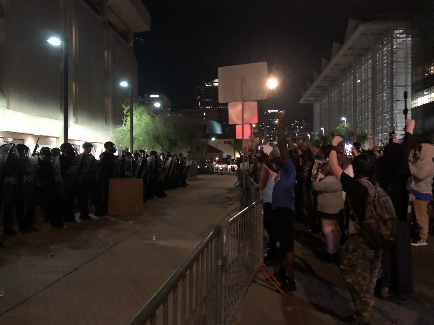 Protesters and Phoenix police officers during a protest.