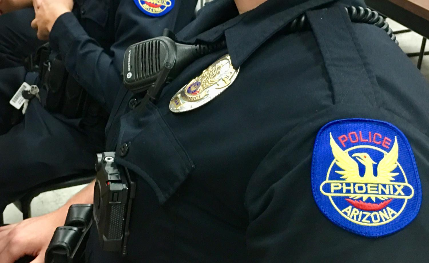 body camera and badge on officer