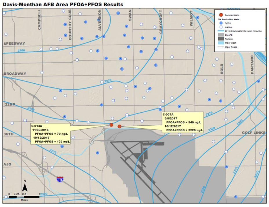 A map showing red dots indicating closed wells near the runway at Davis-Monthan Air Force Base in Tucson.