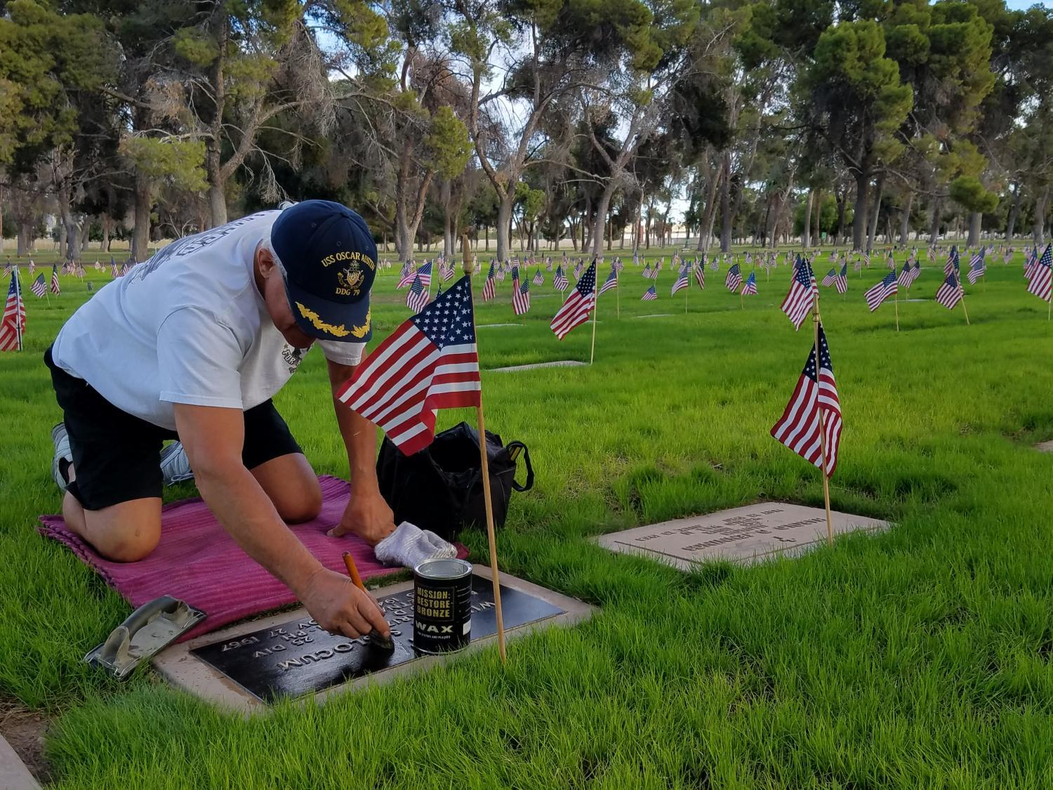 Tom Pawlak works on a grave marker at Greenwood Memory Lawn.
