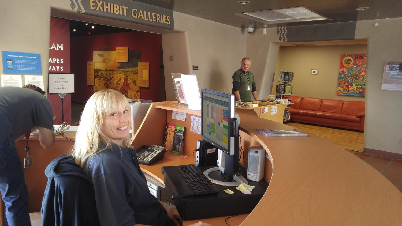 Front Desk Ambassador Volunteer Stephani Jolley and Artifact Cart Volunteer Frank Grinere