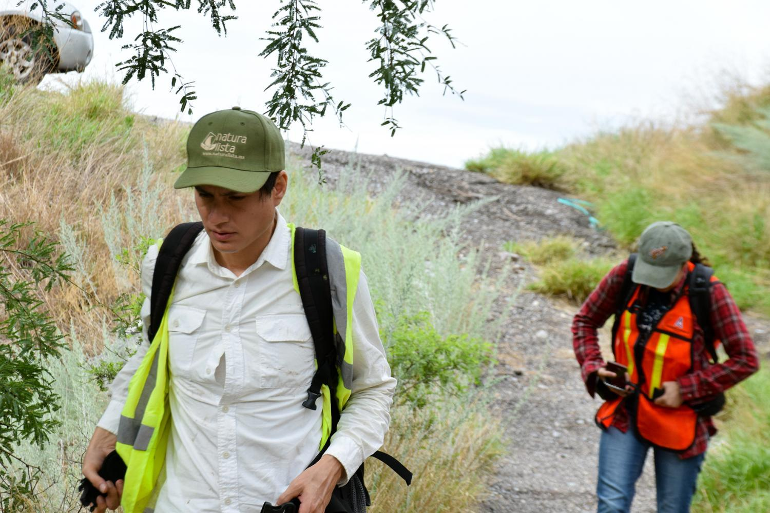 researchers hiking to cameras