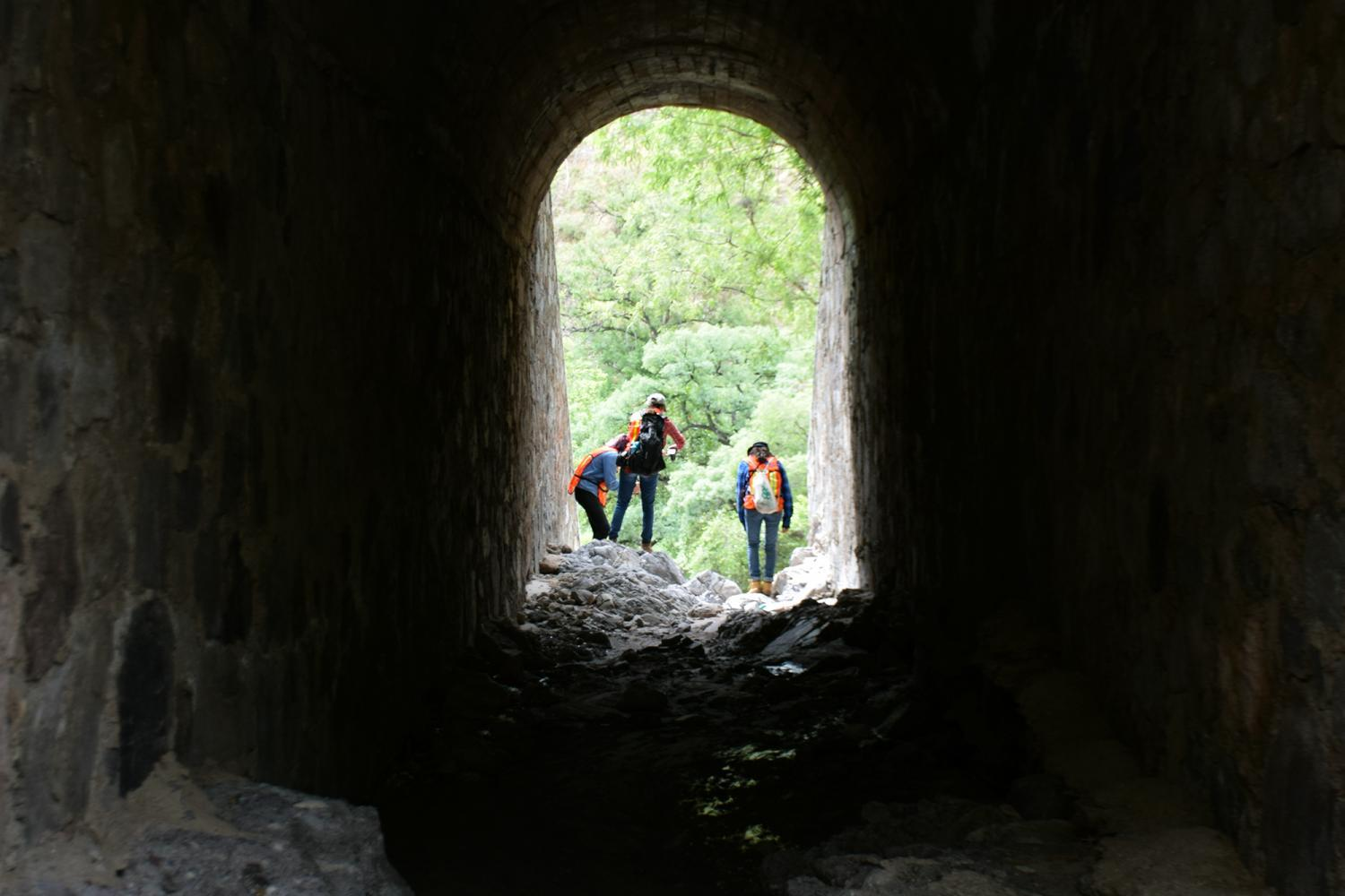researchers inspect a tunnel