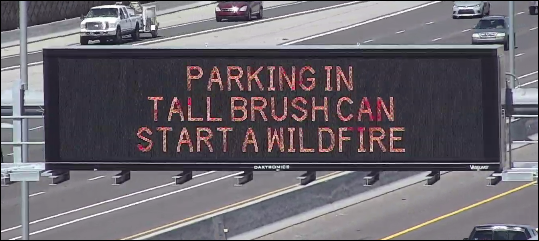 ADOT parking in brush sign
