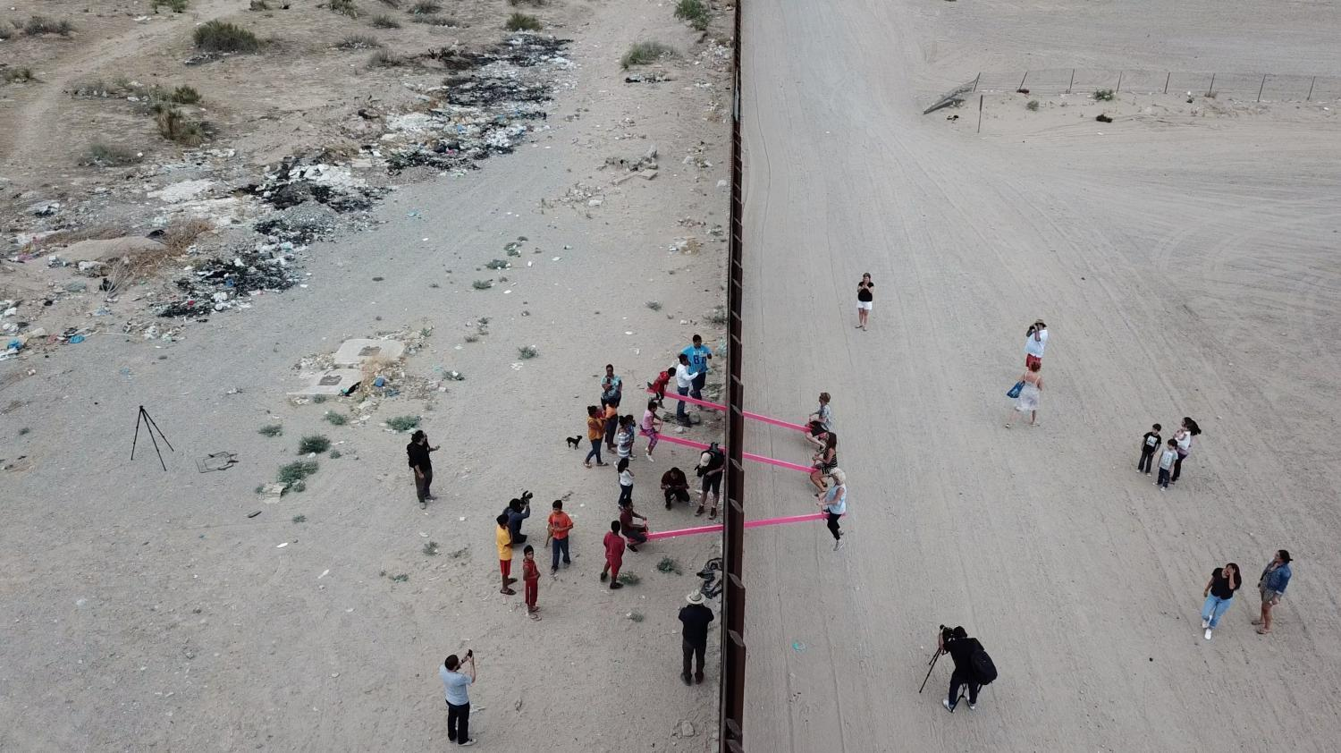 Aerial view of border wall teeter-totters