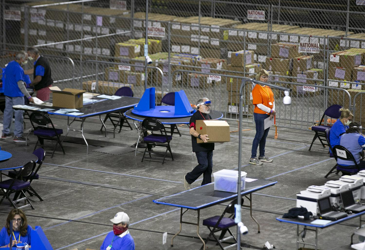 Maricopa County ballots from the 2020 general election are examined and recounted