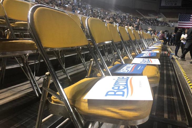 Signs on seats before Sen. Bernie Sanders
