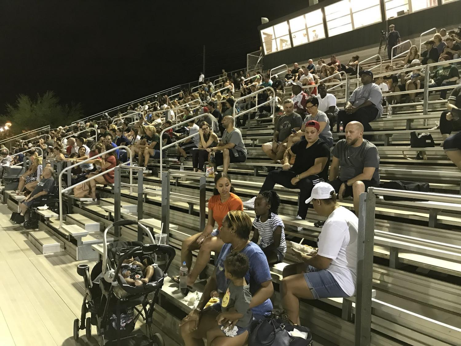Fans watching a football game between Phoenix and Scottsdale Colleges on Sept. 1, 2018.